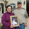 Virginia Farver and her husband Craig (holding a picture of their son)